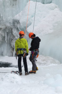 Two climbers in safety belts standing on the ice. Harness Photo: Harness.jpg