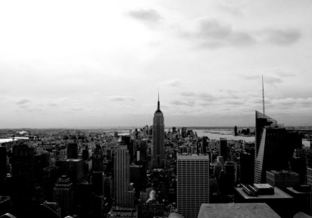 Black and white image of the New York skyline with the Empire State Building.