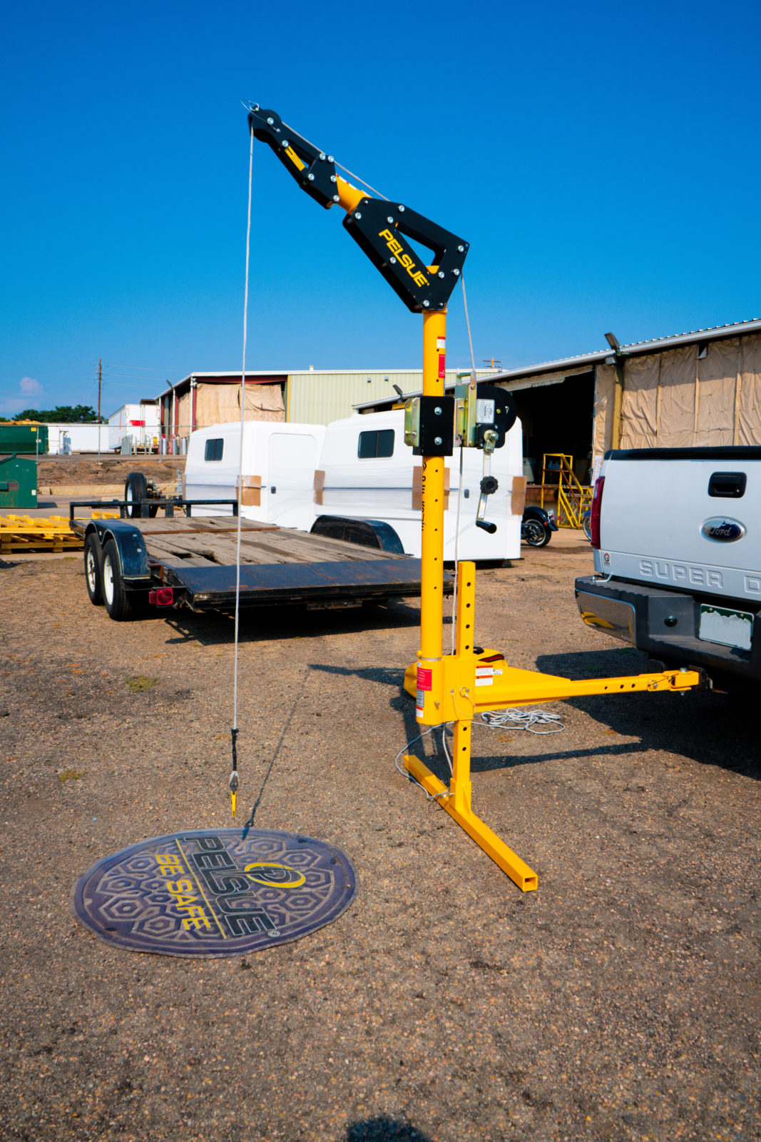 The Pelsue Vehicle Hitch-Mounted Davit System on a work truck.